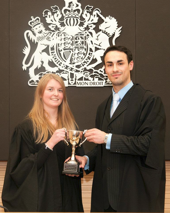 Winners of the 2011 Cwpan Griffiths Welsh Moot, Aaron Bridge and Claire Russell Griffiths (back row)