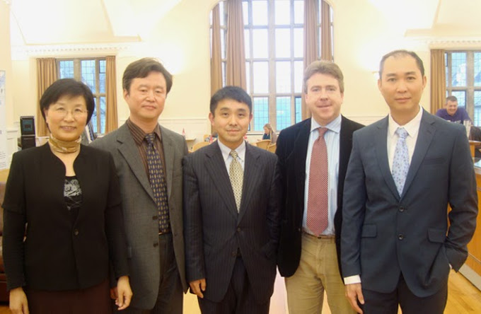 Professor Z Wang (centre) and Professor Jason Chuah (far right), with Bangor Law staff