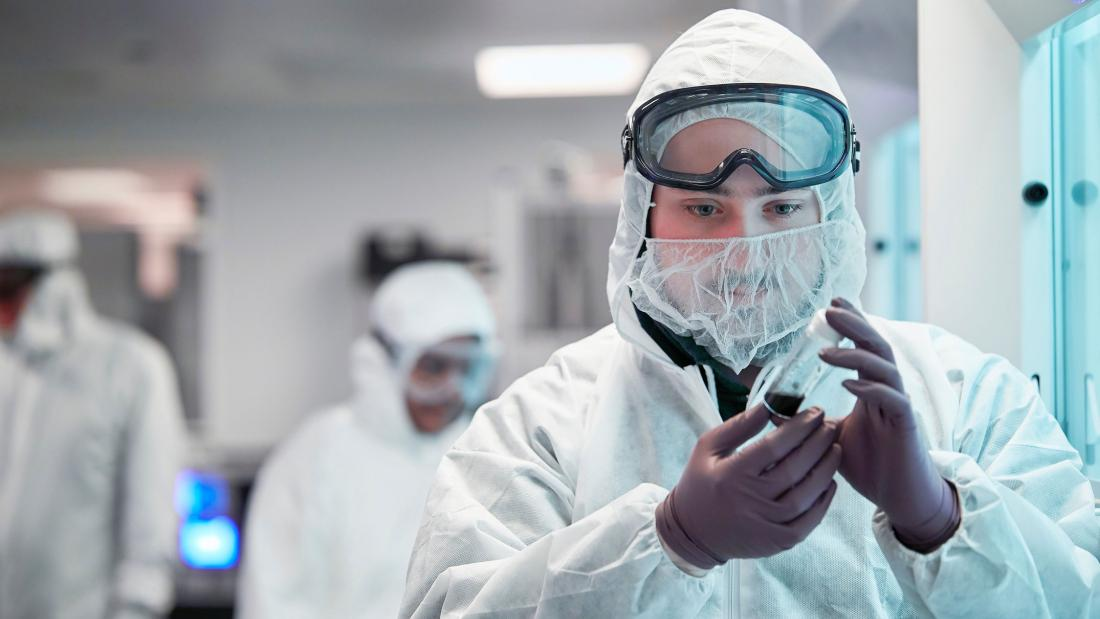 Students wearing protective equipment working in a lab
