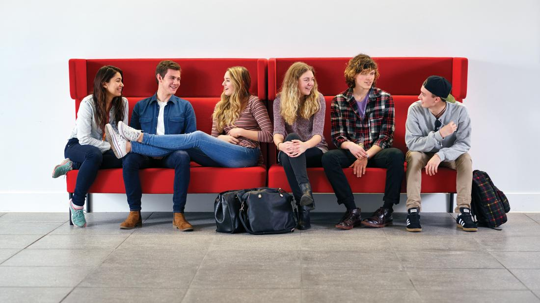 Students sitting on a sofa in Pontio