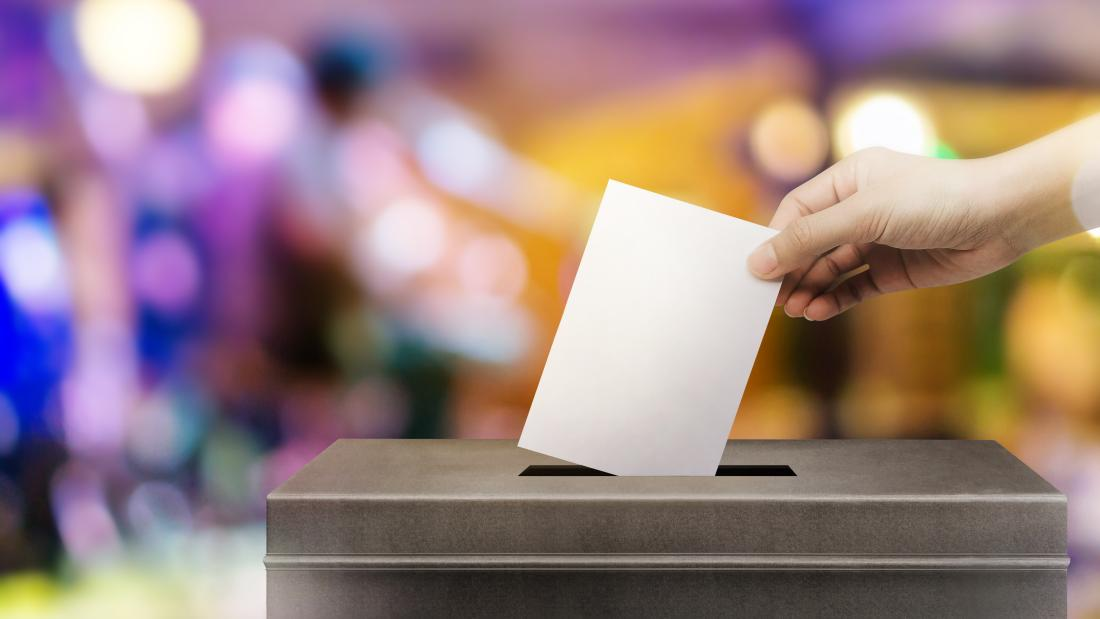 placing a voting paper in a ballot box.