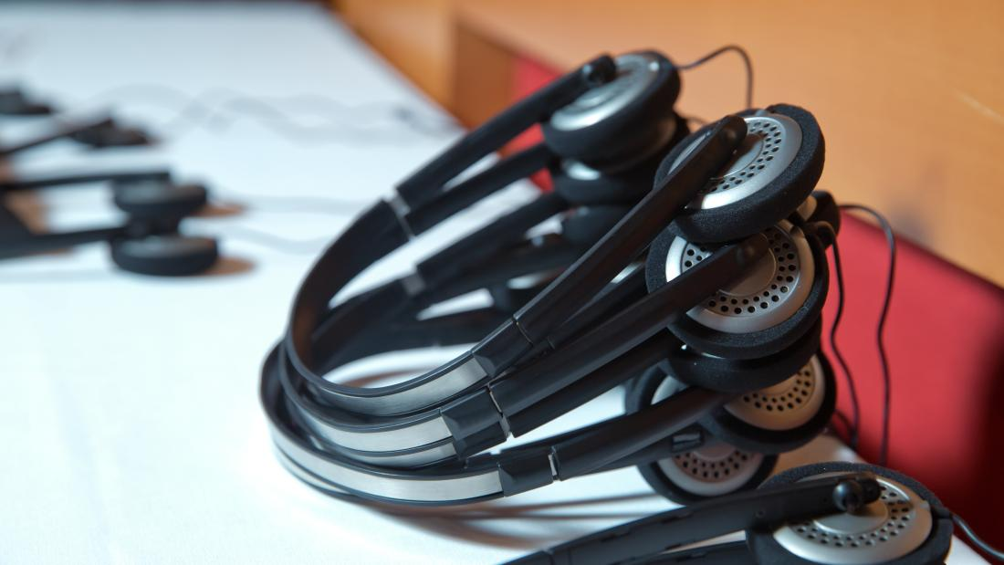 Translation headsets on a boardroom table
