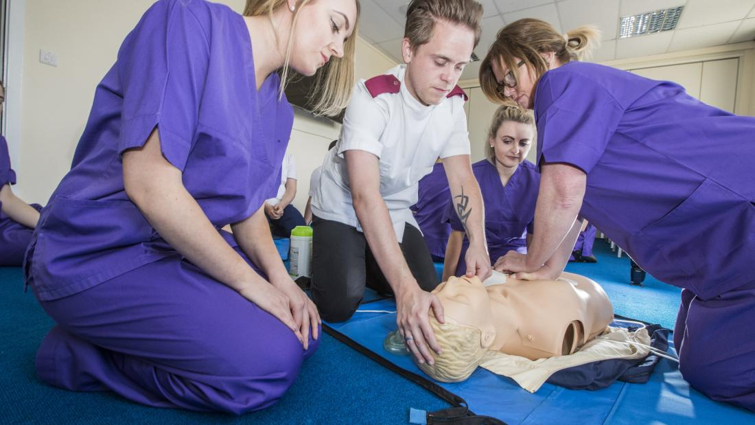 Student nurses learning how to give CPR