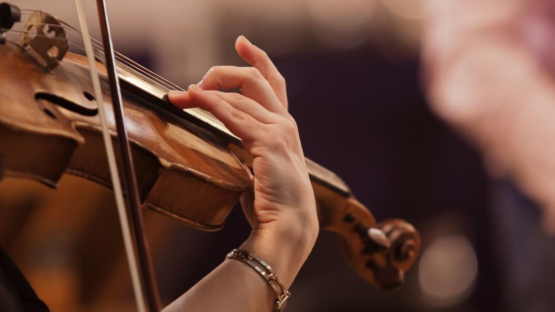 Close-up of a violin being played