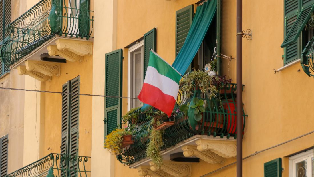 Italian flag hanging from balcony