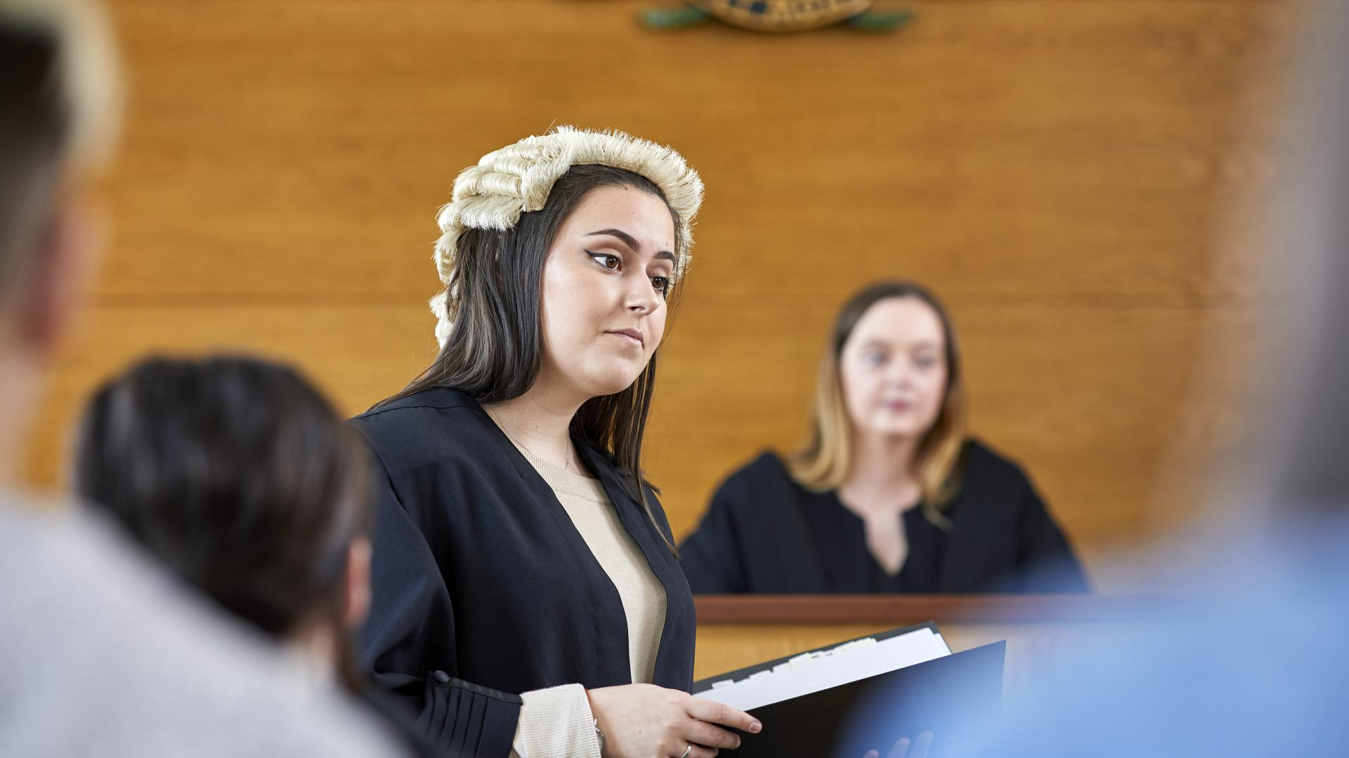 Students mooting in mock courtroom