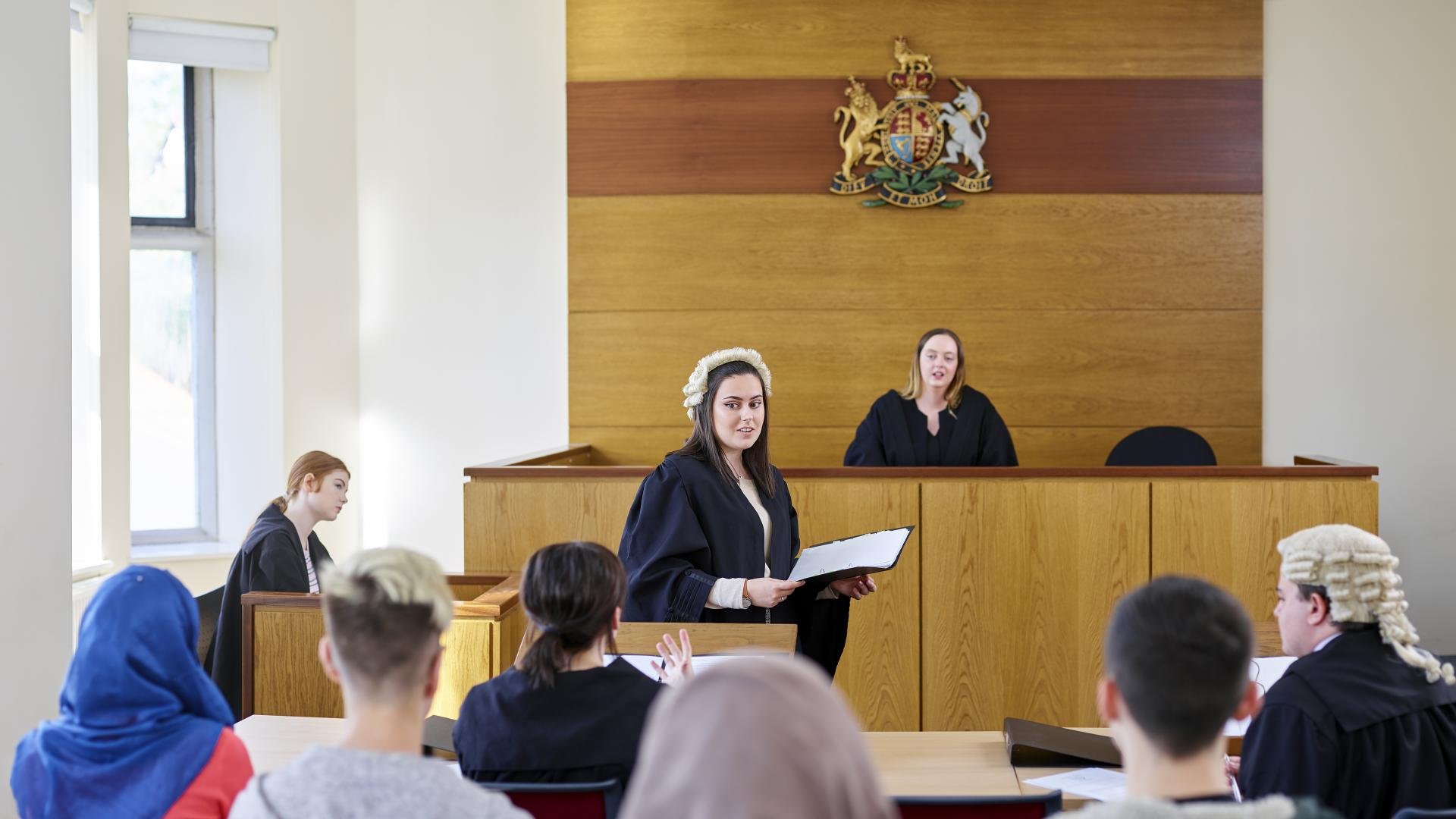 Students mooting in the University mock court room