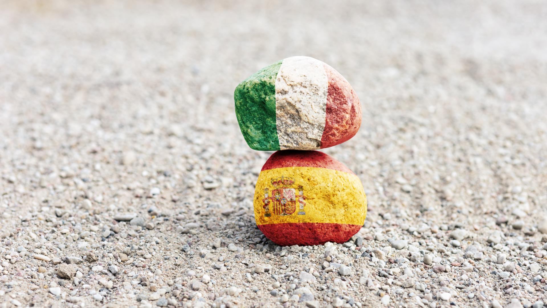 Italy and Spain's flags painted on rocks