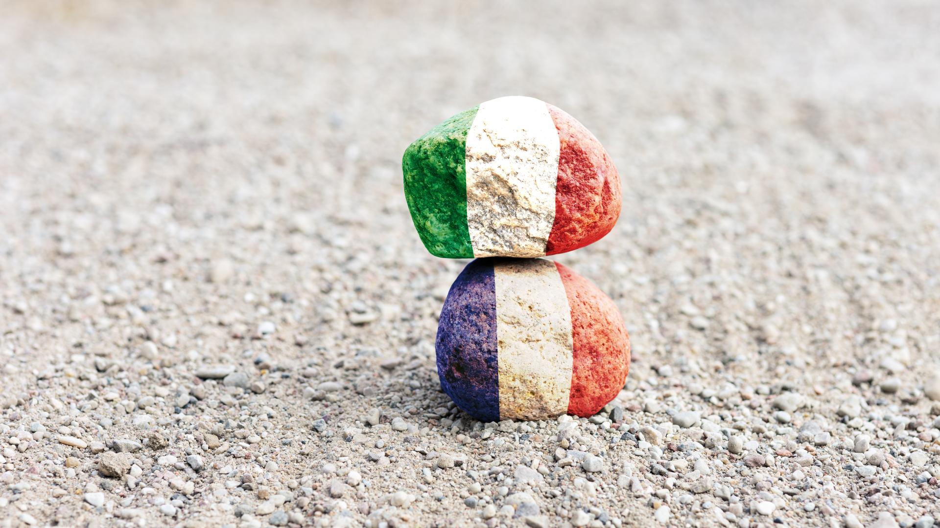 French and Italian flags painted on rocks