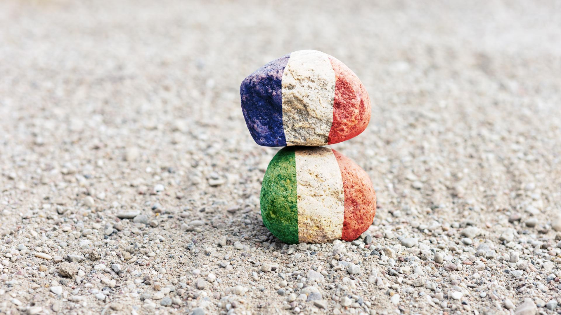 France and Italian flag painted on rocks