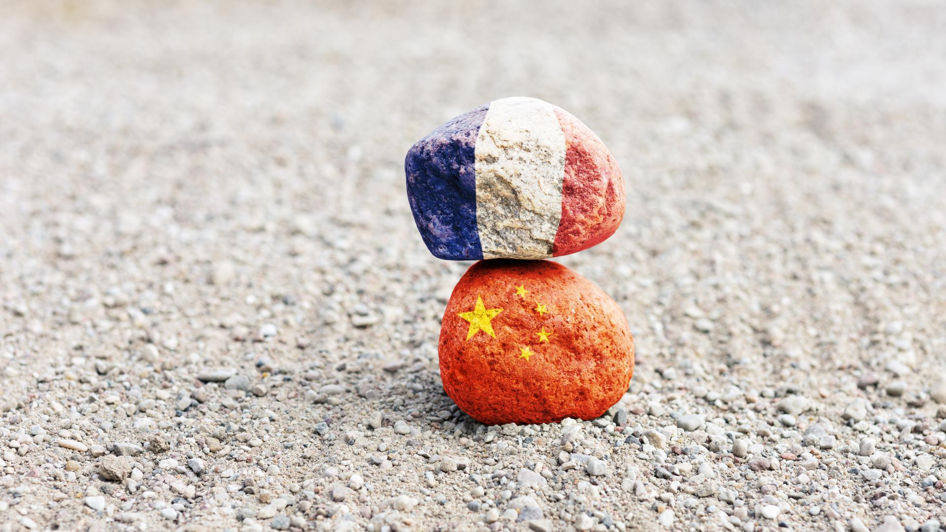 France and China flags painted on rocks