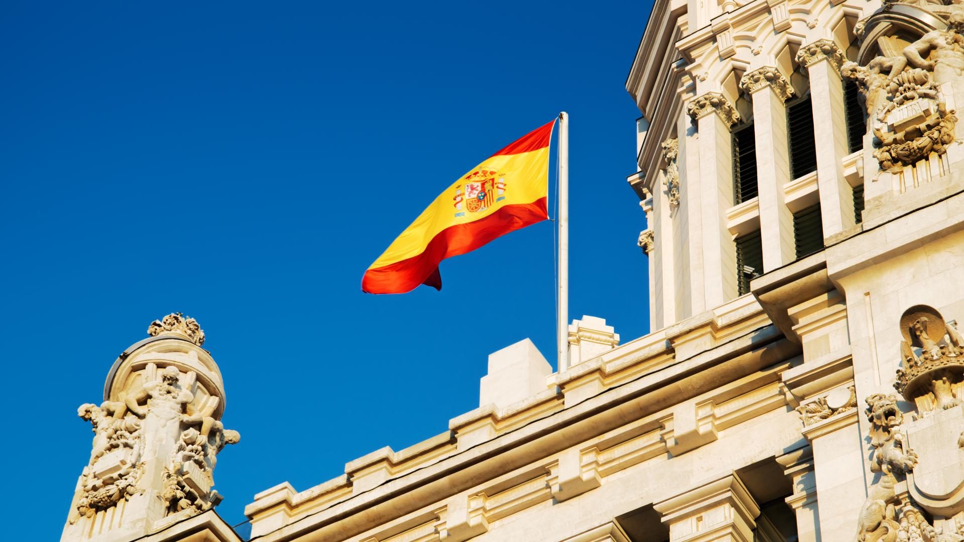 Spanish flag flying on a building in Spain