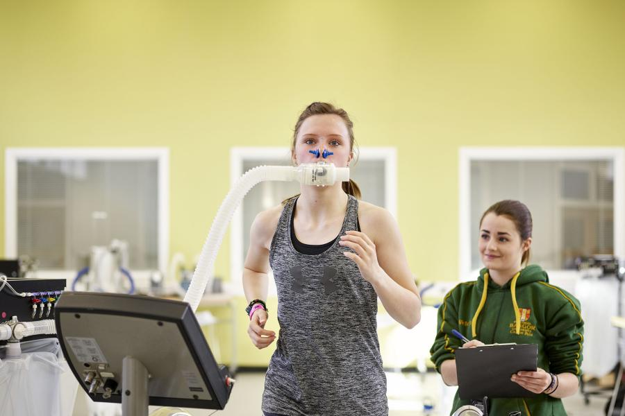 Students measuring oxygen consumption during exercise using a Douglas bag