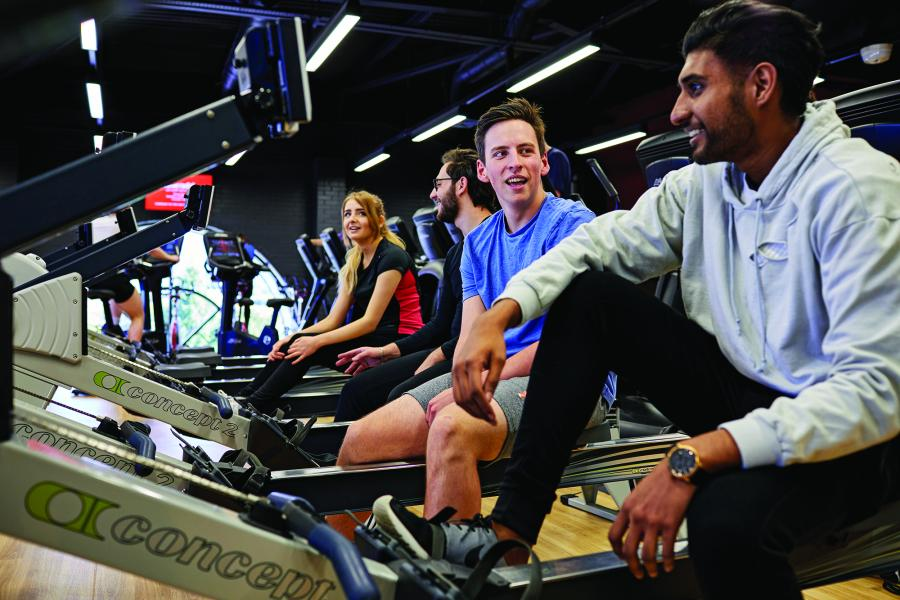Students on the rowing machines at the Canolfan Brailsford gym