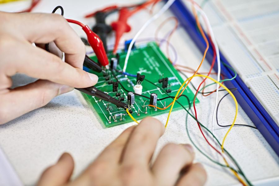 Close-up of a person working on a electrical circuit