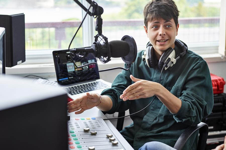 Student using the radio studio facilities at the the School of Music and Media