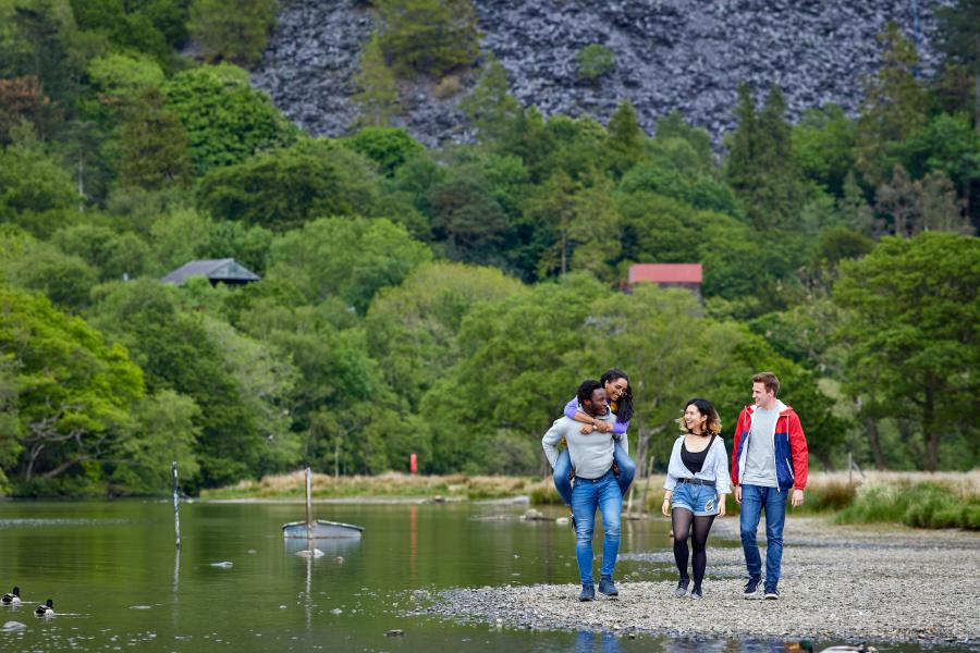 Students having fun by the lake in Llanberis