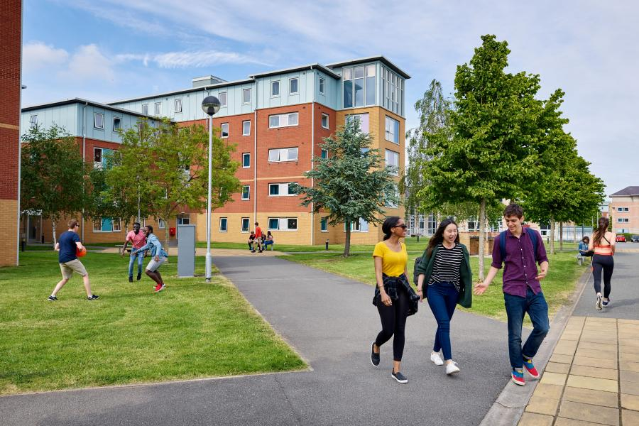 Students walking through Ffriddoedd Student Accommodation