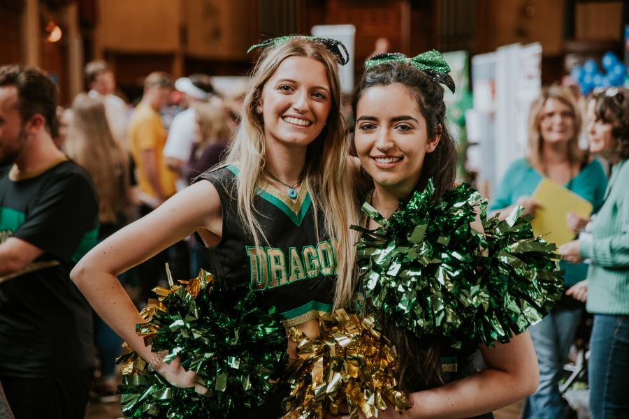 Two cheerleaders at the Serendipity Fair during Welcome Week