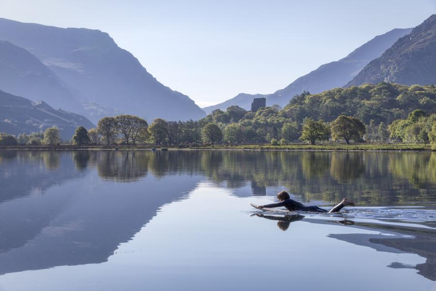 Student paddle boarding on Llyn Padarn in nearby Llanberis
