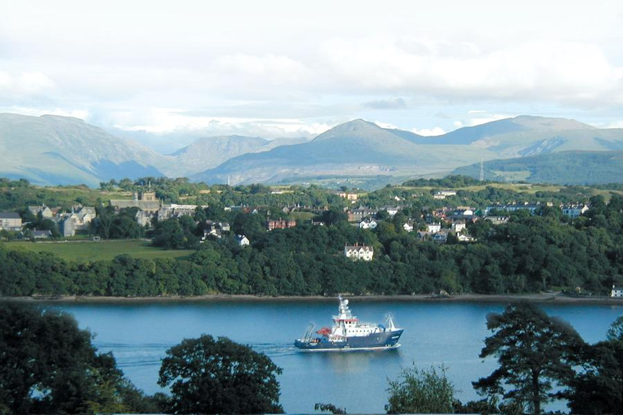 Bangor University's Prince Madog research vessel with Snowdonia mountains in the background