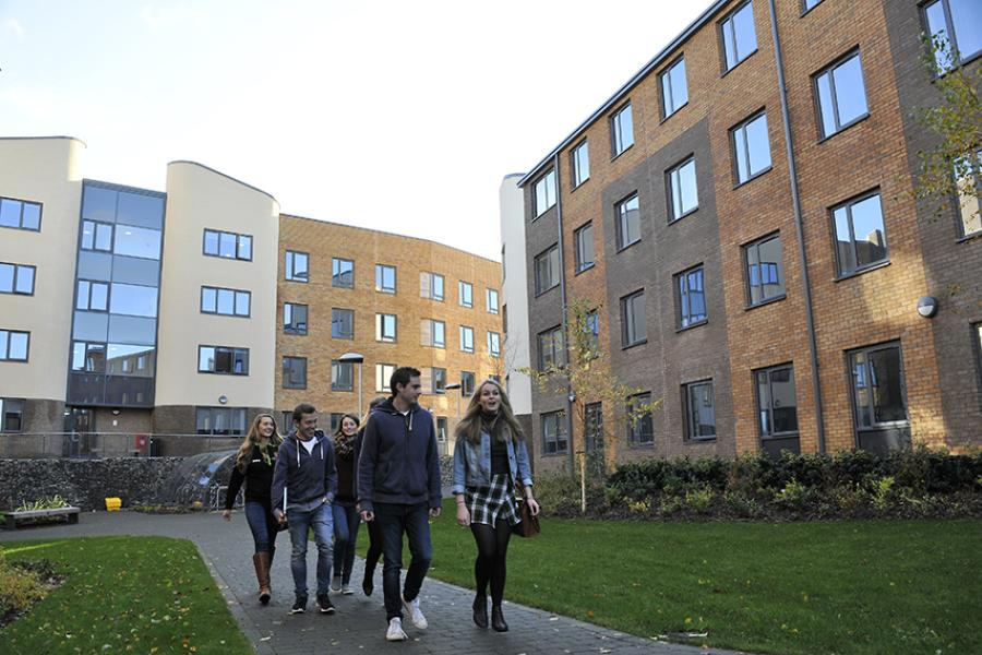 Acccommodation - students walking through St Mary's Student Village