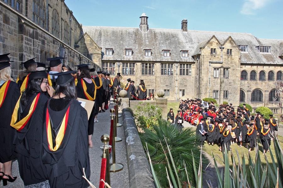 Students gather in the inner quad of the University's Main Arts building on graduation day