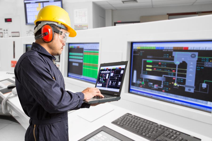Engineer working at a modern thermal power plant