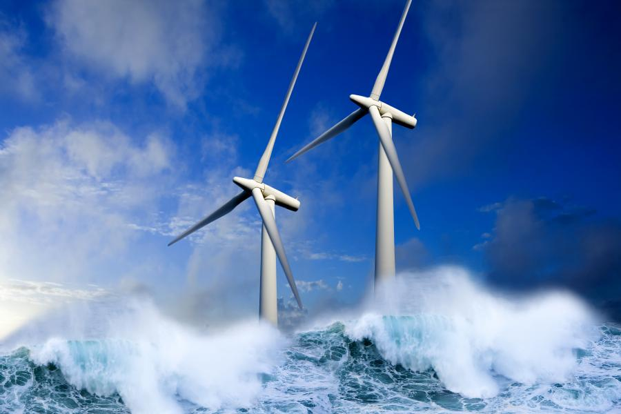 Wind turbines generating green energy at sea.