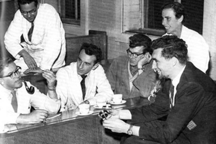 An old photo of students and academics talking to each other, Bangor University