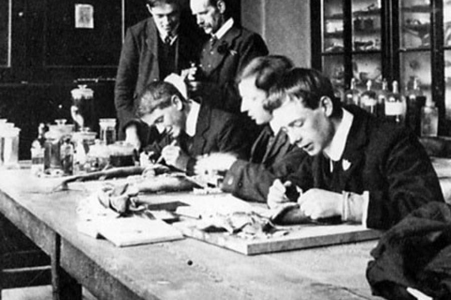 Old photo of students working in the laboratory, Bangor University