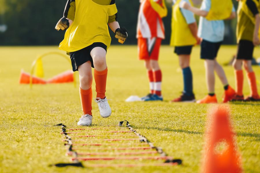 Young athletes training on grass