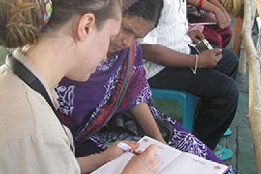 Conservation researcher completing a questionnaire in the field