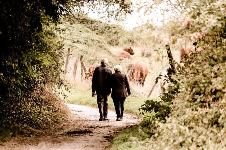 An older couple walking in countryside