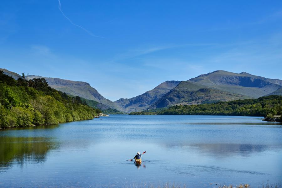 Lone Student kayaking on the Llyn Padarn lake in Llanberis